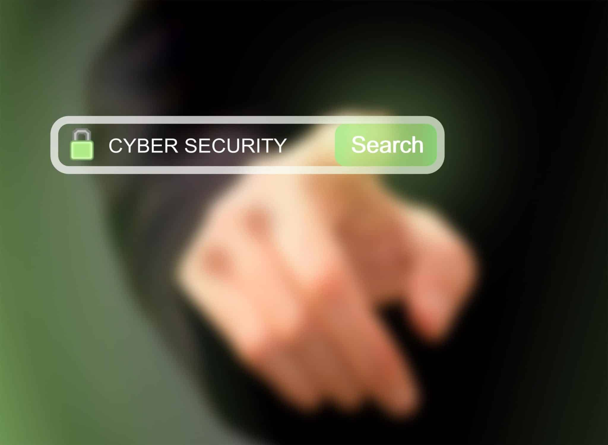Businessman pressing cybersecurity search button on a virtual screen